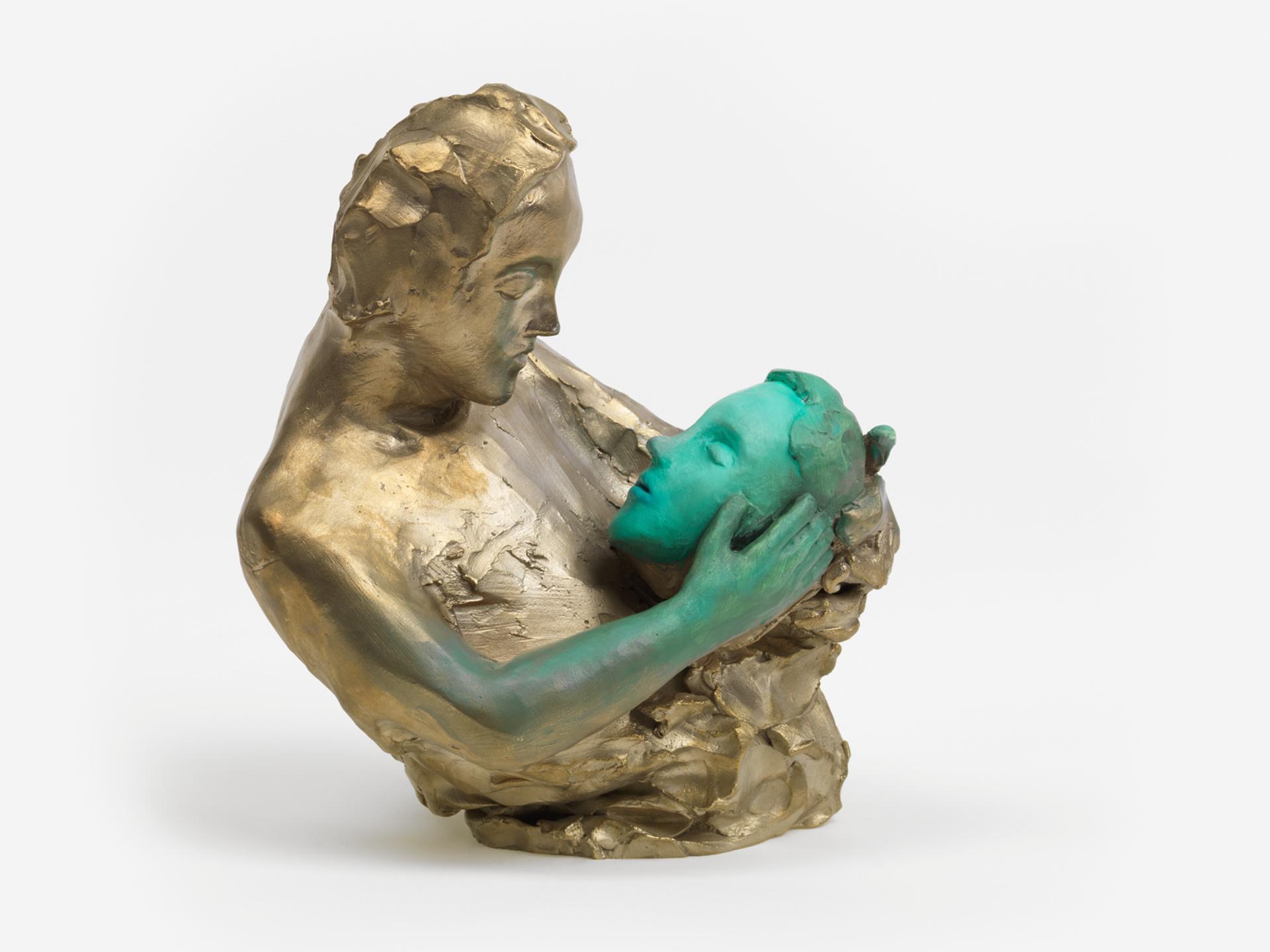 Figure Holding a Green Head